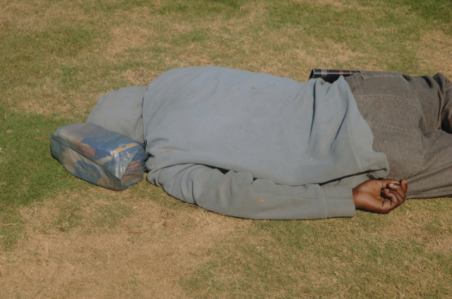 Man asleep on the Golden Mile, Durban, South Africa. Photo by Michelle Sank